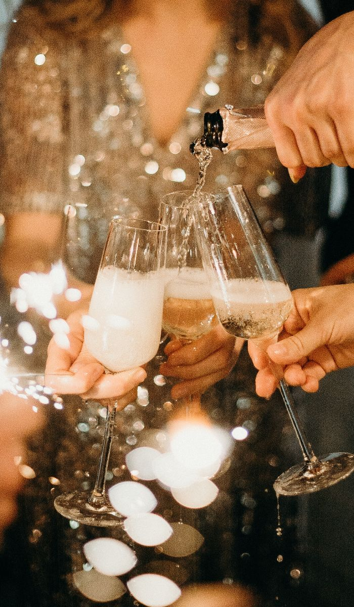 person-pouring-champagne-on-champagne-flutes-3171770(1)